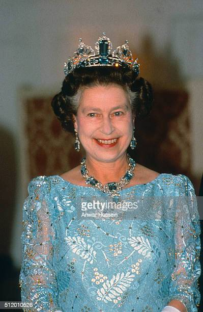 Queen Elizabeth ll wearing the Brazilian Aquamarine Prure Tiara and necklace smiles as she attends a banquet in Canton during her visit to China on...
