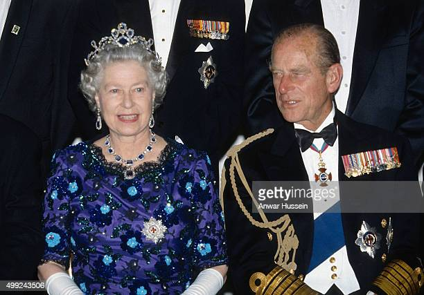 Queen Elizabeth ll wearing the Garter Star and Prince Philip Duke of Edinburgh attend a banquet to commemorate DDay on May 4 1994 in Portsmouth...