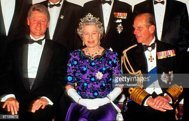 Queen Elizabeth ll wearing the garter star and Prince Phillip the Duke of Edinburgh sit with US President Bill Clinton at a banquet at Portsmouth...