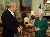 DAYS*** Queen Elizabeth ll who has a large bruise on her neck meets King George Tupou V of Tonga at Buckingham Palace on December 18 2007 in London...
