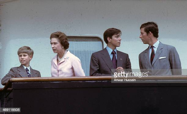 Queen Elizabeth ll with her sons Prince Edward Prince Andrew and Prince Charles Prince of Wales look out from the deck of the Royal Yacht Britannia...