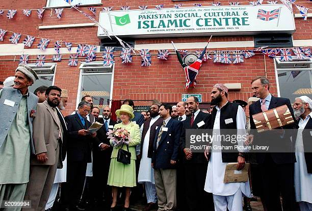 Queen Elizabeth Ll With Members Of The Muslim Community Outside The Pakistan Social Cultural And Islamic Centre After Unveiling A Plaque Which...