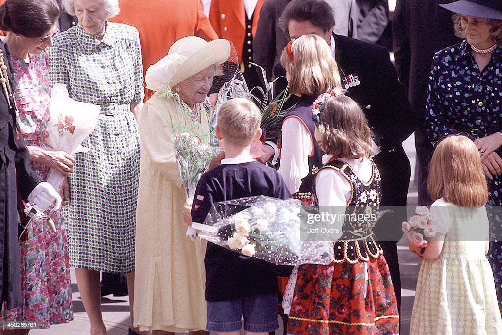 Queen Elizabeth Mother at Clarence House for 99th Birthday Celebrations, 99. She receives flowers from children.