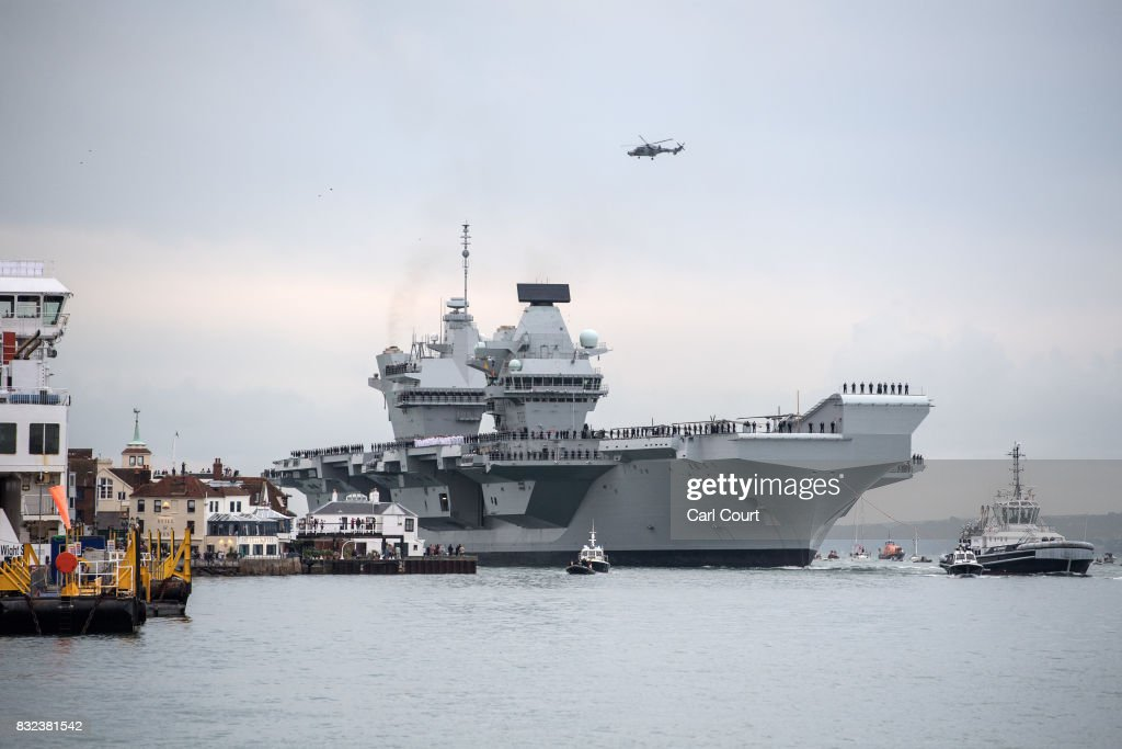 Queen Elizabeth sails into her home port of Portsmouth Naval Base on August 16, 2017 in Portsmouth, England. HMS Queen Elizabeth is the lead ship in the new Queen Elizabeth class of supercarriers. Weighing in at 65,000 tonnes she is the largest warship deployed by the British Royal Navy. She is planned to be in service by 2020 and with a second ship, HMS Prince of Wales, to follow.