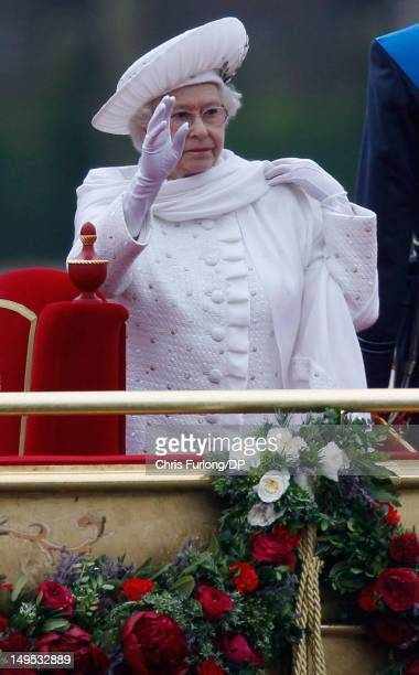Queen Elizabeth sails on the royal barge 'The Spirit of Chartwell' during the Thames Diamond Jubilee River Pageant during the Thames Diamond Jubilee...