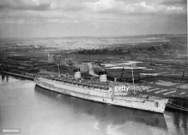 RMS Queen Elizabeth seen here lying againt berth 101 in Greenock at the John Brown Shipyard after a small internal fire had been extinguished 17th...