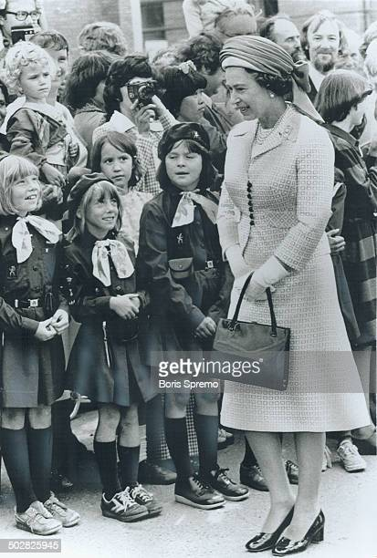 Queen Elizabeth talks to Brownies at sodturning ceremony in Grande Prairie Alta One reader says majority oppose visit Others criticize Prime Minister...