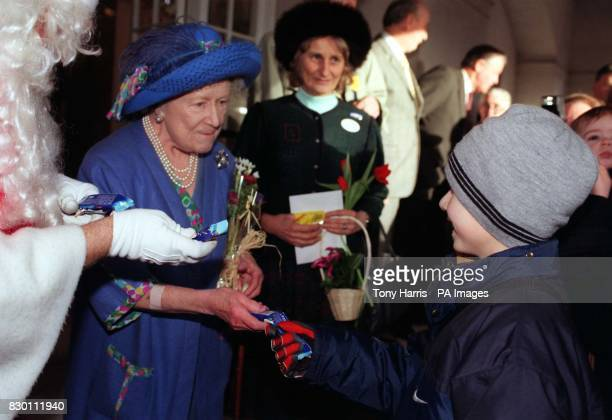 Queen Elizabeth The Queen Mother aided and abetted by Santa gave gifts of chocolate bars to children at Ascot races today Photo by Tony Harris/PA