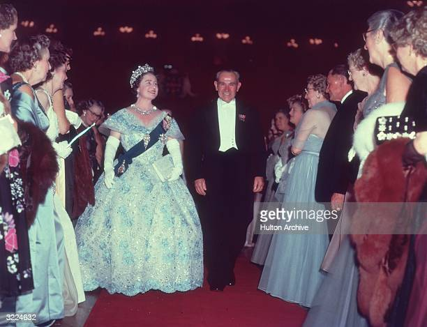 Queen Elizabeth the Queen Mother attending a state reception with J Cahill the Premier of New South Wales during her royal tour of Australia