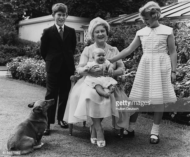 Queen Elizabeth the Queen Mother in the garden of Clarence House on the occasion of her 60th birthday with her grandchildren Prince Charles Princess...