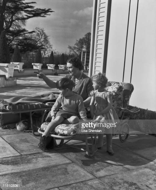 Queen Elizabeth The Queen Mother with her grandchildren Prince Charles and Princess Anne on the patio of the Royal Lodge in Windsor England on April...
