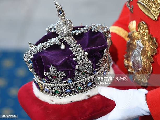 Queen Elizabeth's Imperial State Crown arrives at the State Opening of Parliament in the House of Lords at the Palace of Westminster on May 27 2015...