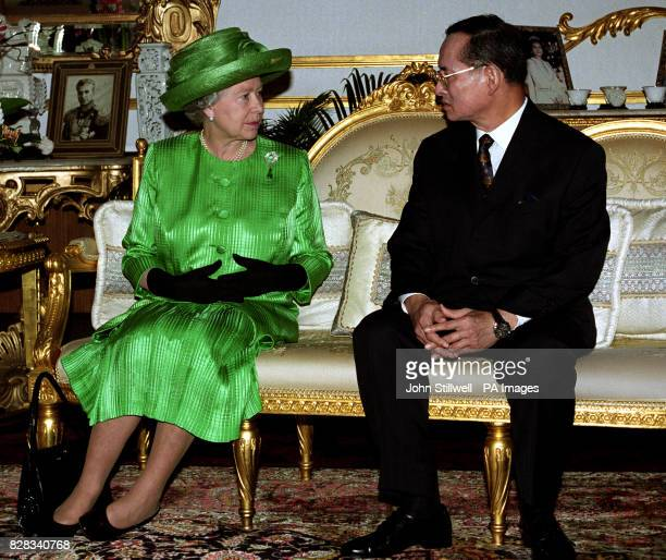 Queen Elizabth II chats with the King of Thailand following her arrival in Bangkok for a state visit