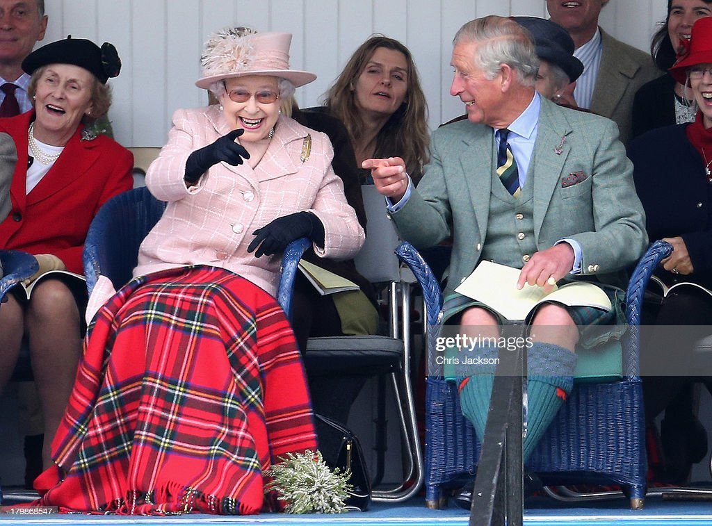 Queen Ellizabeth II and <a gi-track='captionPersonalityLinkClicked' href=/galleries/search?phrase=Prince+Charles+-+Prince+of+Wales&family=editorial&specificpeople=160180 ng-click='$event.stopPropagation()'>Prince Charles</a>, Prince of Wales laugh as they watch the sack race during the annual Braemer Highland Games at The Princess Royal and Duke of Fife Memorial Park on September 7, 2013 in Braemar, Scotland. The Braemar Gathering is the most famous of the Highland Games and is known worldwide. Each year thousands of visitors descend on this small Scottish village on the first Saturday in September to watch one of the more colourful Scottish traditions. The Gathering has a long history and in its modern form it stretches back nearly 200 years.