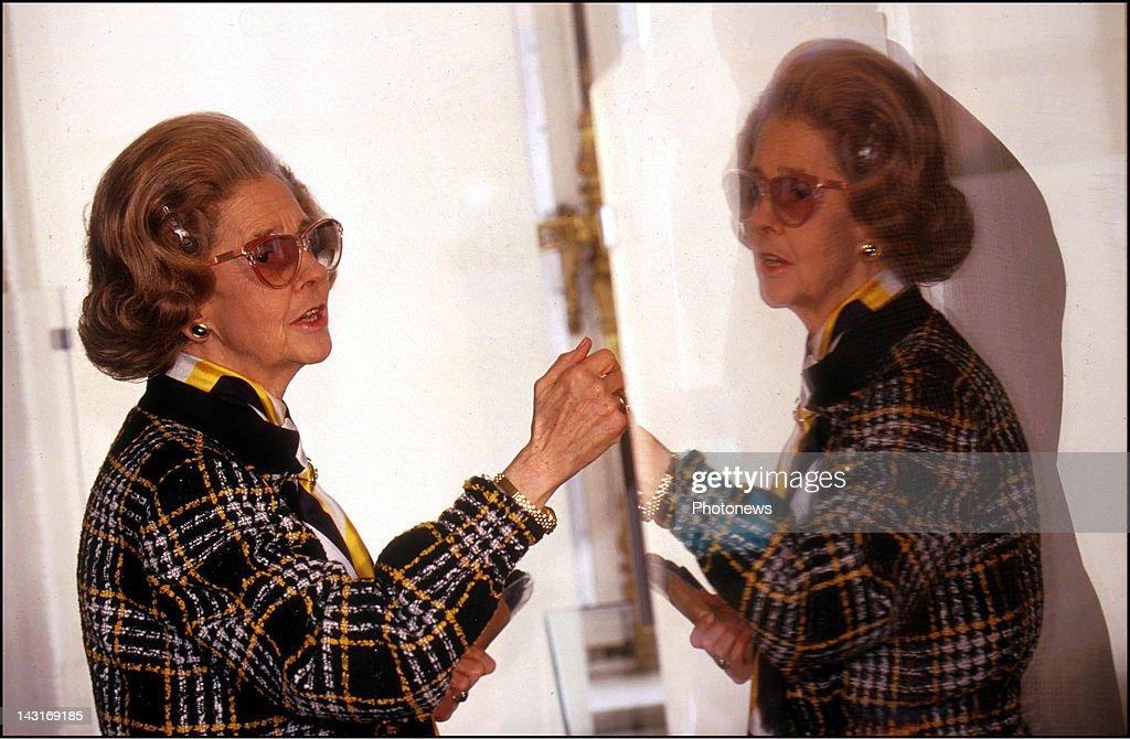 Queen Fabiola of Belgium guides Prince Felipe of Spain through the King Baudouin memorial