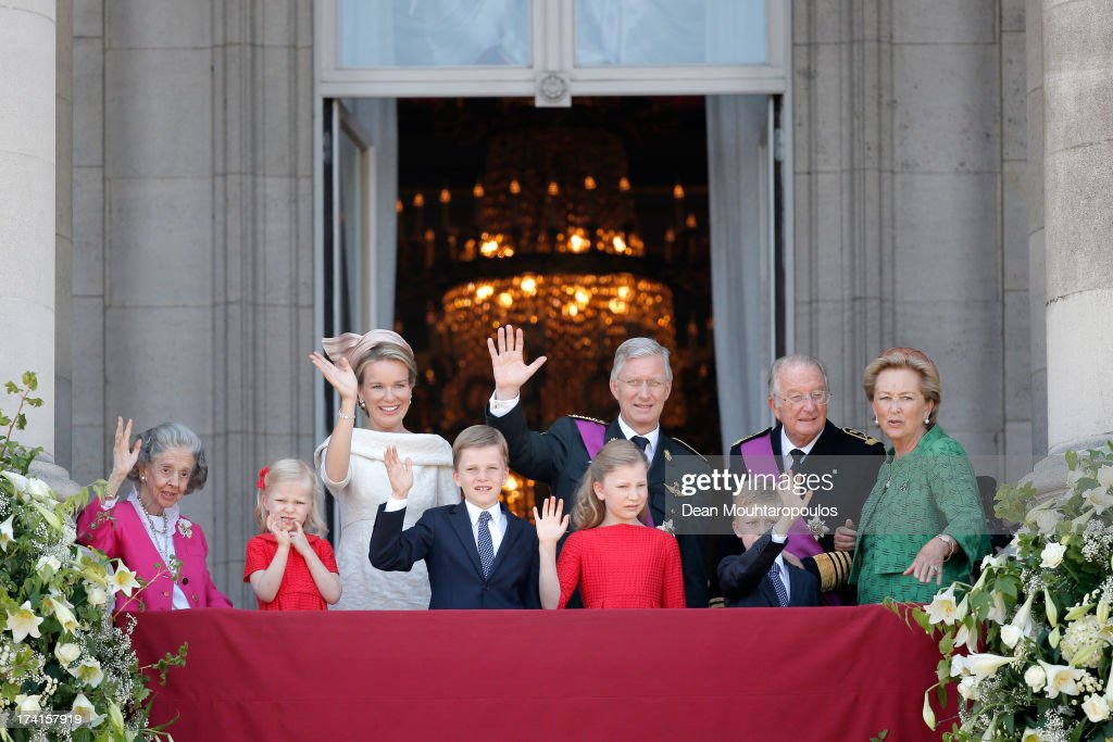 Queen Fabiola of Belgium, Princess Eleonore of Belgium, Prince Gabriel of Belgium,Queen Mathilde of Belgium,Princess Elisabeth of Belgium, King Philippe of Belgium, Prince Emmanuel of Belgium,King Albert II of Belgium and Queen Paola of Belgium are seen greeting the audience from the balcony of the Royal Palace during the Abdication Of King Albert II Of Belgium, & Inauguration Of King Philippe on July 21, 2013 in Brussels, Belgium.