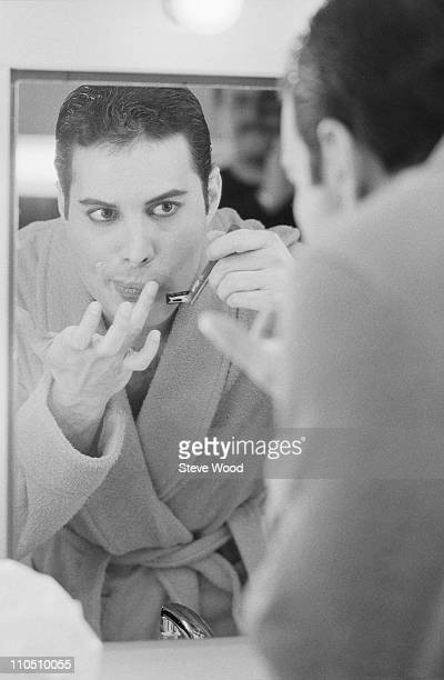 Queen frontman Freddie Mercury shaving his moustache 12th April 1984