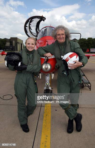 Queen guitarist Brian May and West End actress Kerry Ellis during a training sortie with the Red Arrows at RAF Scampton in Lincolnshire