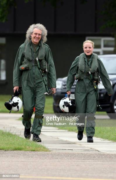Queen guitarist Brian May and West End Actress Kerry Ellis fly a training sortie with the Red Arrows at RAF Scampton in Lincolnshire