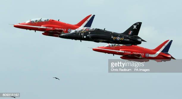 Queen guitarist Brian May and West End actress Kerry Ellis fly with the Red Arrows during a training sortie at RAF Scampton in Lincolnshire