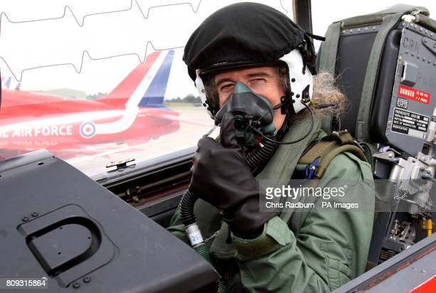 Queen guitarist Brian May in the cockpit during a training sortie with the Red Arrows at RAF Scampton in Lincolnshire