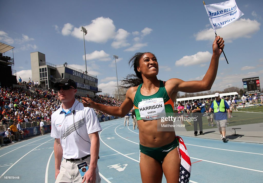 Queen Harrison, of Saucony, celebrates after winning the Women's 100-meter Hurdles London Games Rematch at the Drake Relays, on April 27, 2013 at Drake Stadium, in Des Moines, Iowa.