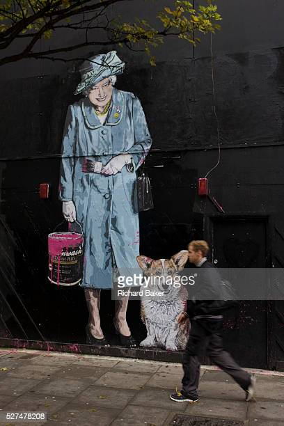 Queen holding paint can and pet corgi dog mural by artist Mr Brainwash at the Old Sorting Office New Oxford Street London Mr Brainwash is the moniker...