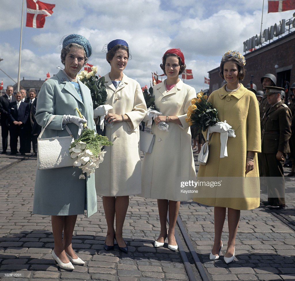 <a gi-track='captionPersonalityLinkClicked' href=/galleries/search?phrase=Queen+Ingrid+of+Denmark&family=editorial&specificpeople=507762 ng-click='$event.stopPropagation()'>Queen Ingrid of Denmark</a> (1910-2000) holding a bouquet of flowers with her daughters, Princess Margrethe, Princess Benedikte, and Princess Anne-Marie, in Randers, Denmark, June 1964.