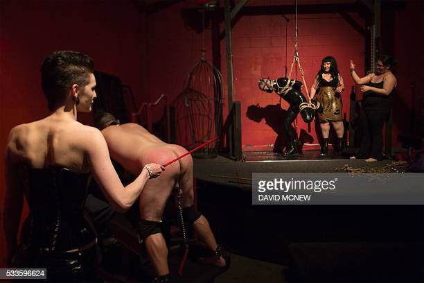 Queen IV dominates a voluntary submissive man at a dungeon party during the DomCon LA domination convention on May 22 2016 in Los Angeles California...