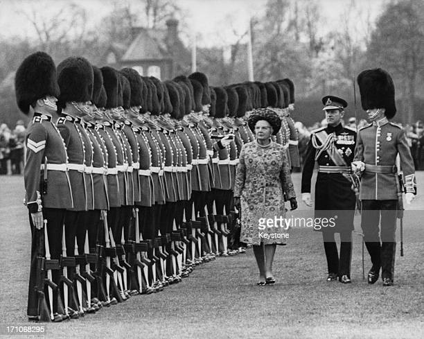 Queen Juliana of the Netherlands inspecting a guard of honour at Home Park Windsor at the start of her state visit to Britain 11th April 1972 With...