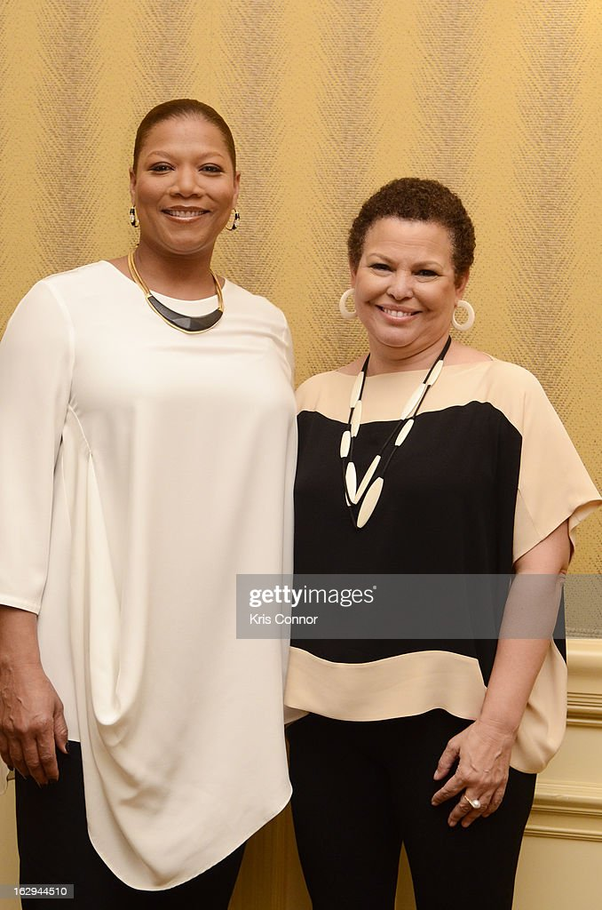 Queen Latifah and Debra Lee pose for a photo during the Leading Women Defined: Girl's Night Out at Ritz Carlton Hotel on March 1, 2013 in Washington, DC.