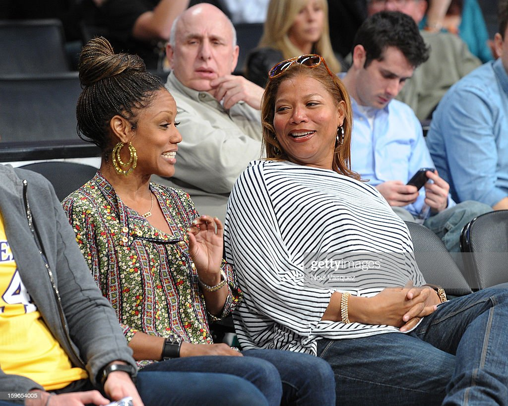 Queen Latifah (R) attends a basketball game between the Miami Heat and the Los Angeles Lakers at Staples Center on January 17, 2013 in Los Angeles, California.