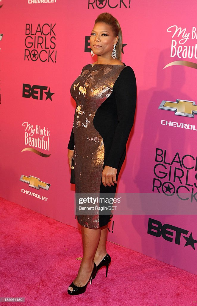 <a gi-track='captionPersonalityLinkClicked' href=/galleries/search?phrase=Queen+Latifah&family=editorial&specificpeople=171793 ng-click='$event.stopPropagation()'>Queen Latifah</a> attends BET Black Girls Rock Red Carpet at New Jersey Performing Arts Center on October 26, 2013 in Newark, New Jersey.