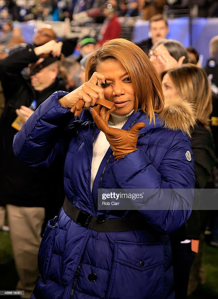 <a gi-track='captionPersonalityLinkClicked' href=/galleries/search?phrase=Queen+Latifah&family=editorial&specificpeople=171793 ng-click='$event.stopPropagation()'>Queen Latifah</a> pretends to take a photo before the Seattle Seahawks take on the Denver Broncos during Super Bowl XLVIII at MetLife Stadium on February 2, 2014 in East Rutherford, New Jersey.