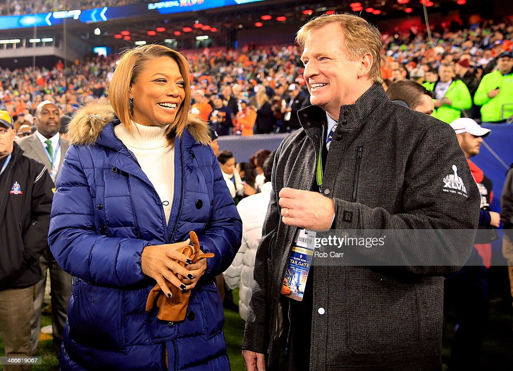 <a gi-track='captionPersonalityLinkClicked' href=/galleries/search?phrase=Queen+Latifah&family=editorial&specificpeople=171793 ng-click='$event.stopPropagation()'>Queen Latifah</a> talks with NFL Commissioner <a gi-track='captionPersonalityLinkClicked' href=/galleries/search?phrase=Roger+Goodell&family=editorial&specificpeople=744758 ng-click='$event.stopPropagation()'>Roger Goodell</a> before the Seattle Seahawks take on the Denver Broncos during Super Bowl XLVIII at MetLife Stadium on February 2, 2014 in East Rutherford, New Jersey.
