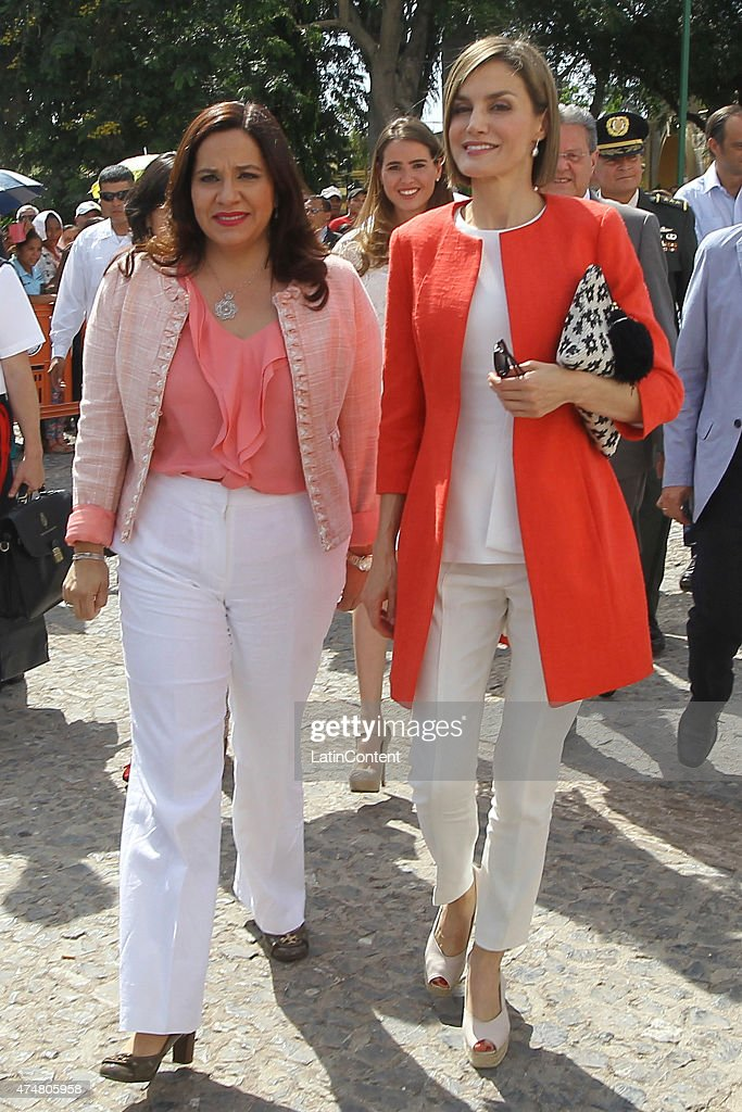 Queen Letizia (right) and Ana Garcia de Hernandez Honduras' First Lady (left), walk through Comayagua, 80 km north of Tegucigalpa, during an official visit on May 26, 2015 in Honduras. Queen Letizia started a two-day visit to Honduras to supervise Spanish cooperation programs in the country.