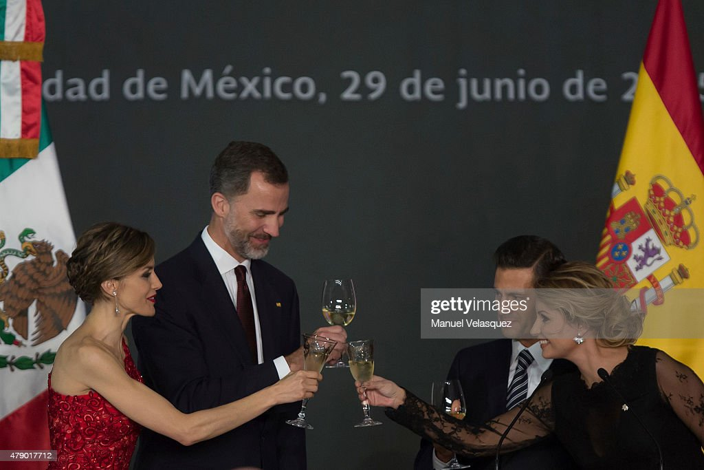 Queen Letizia and King <a gi-track='captionPersonalityLinkClicked' href=/galleries/search?phrase=Felipe+VI+of+Spain&family=editorial&specificpeople=4881076 ng-click='$event.stopPropagation()'>Felipe VI of Spain</a>, Enrique Peña Nieto President of Mexico and First Lady of Mexico <a gi-track='captionPersonalityLinkClicked' href=/galleries/search?phrase=Angelica+Rivera&family=editorial&specificpeople=4327597 ng-click='$event.stopPropagation()'>Angelica Rivera</a> make a toast during a state dinner given by Mexican President Enrique Peña Nieto and his wife First Lady <a gi-track='captionPersonalityLinkClicked' href=/galleries/search?phrase=Angelica+Rivera&family=editorial&specificpeople=4327597 ng-click='$event.stopPropagation()'>Angelica Rivera</a> at National Palace on June 29, 2015 in Mexico City, Mexico. The Spanish Monarchs are in their second state visit since the proclamation of Felipe VI as Spanish King last June 19th of 2014.