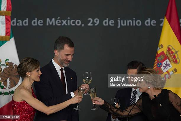 Queen Letizia and King Felipe VI of Spain Enrique Peña Nieto President of Mexico and First Lady of Mexico Angelica Rivera make a toast during a state...