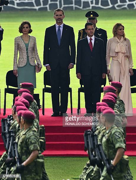 Queen Letizia King Felipe VI of Spain Mexican President Enrique Pena Nieto and Mexican First Lady Angelica Rivera attend a ceremony at the Campo...