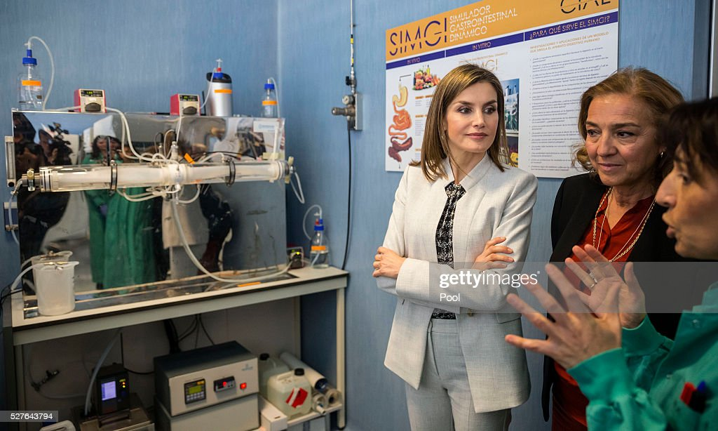 Queen Letizia of Spain, accompanied by Secretary of State of Investigation, Development and Innovation Carmen Vela (2nd R), during a visit to the Institute of Food Science Research (CIAL) on May 3, 2016 in Madrid, Spain.