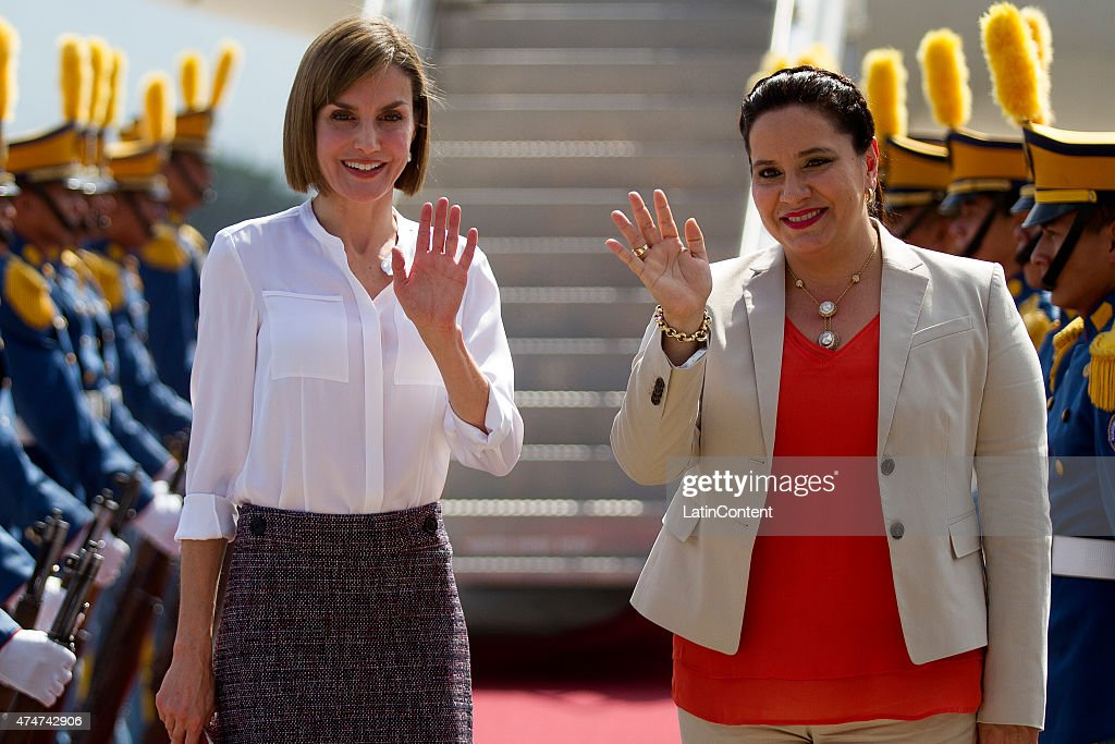 Queen Letizia of Spain (Left) and Ana García Carías, First Lady of Honduras (Right), salute at Soto Cano Air Base on May 25, 2015 in Comayagua, Honduras. Queen Letizia started a two-day visit to Honduras to supervise Spanish cooperation programs in the country.