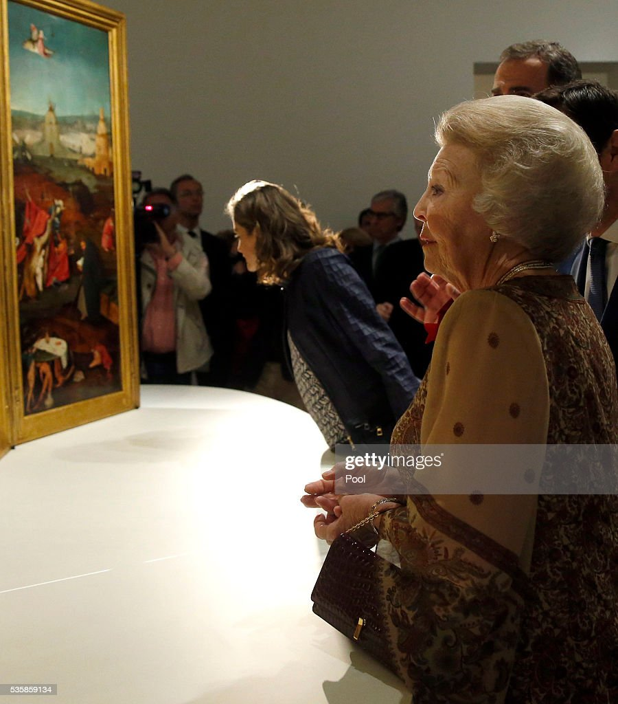 Queen Letizia of Spain (L) and Beatrix of the Netherlands view 'The Temptation of St. Anthony' by Hieronymus Bosch during a visit to the 'El Bosco' 5th Centenary Anniversary Exhibition at El Prado Museum on May 30, 2016 in Madrid, Spain.