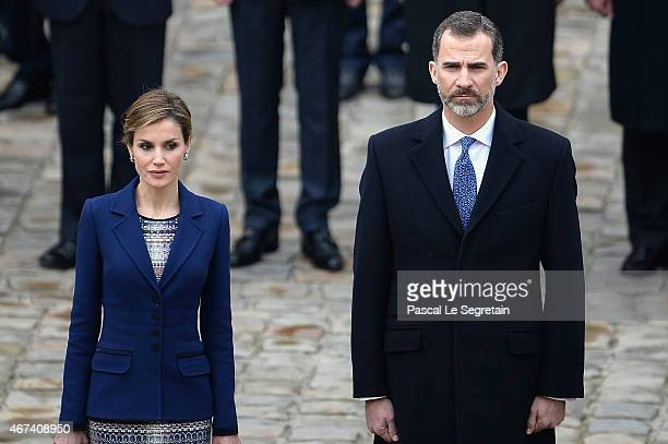 Queen Letizia of Spain and King Felipe of Spain wave to the crowd during a cermony in the courtyard of the Invalides as part of a three day official...