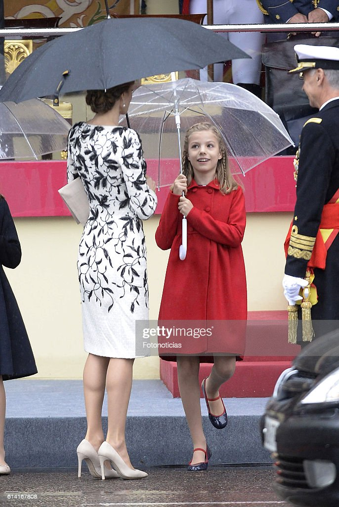 Queen Letizia of Spain (C) and Princess Sofia of Spain (R) attend the National Day military parade on October 12, 2016 in Madrid, Spain