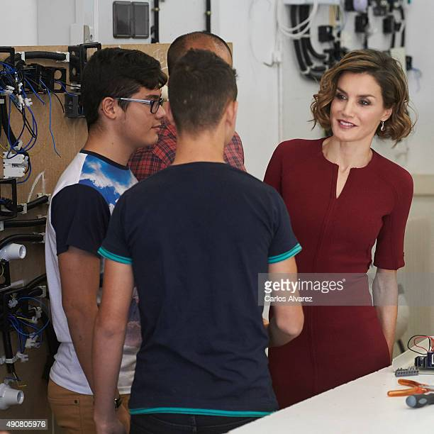 Queen Letizia of Spain attends the vocational training opening course at the 'Javier Garcia Tellez' secondary School on October 1 2015 in Caceres...