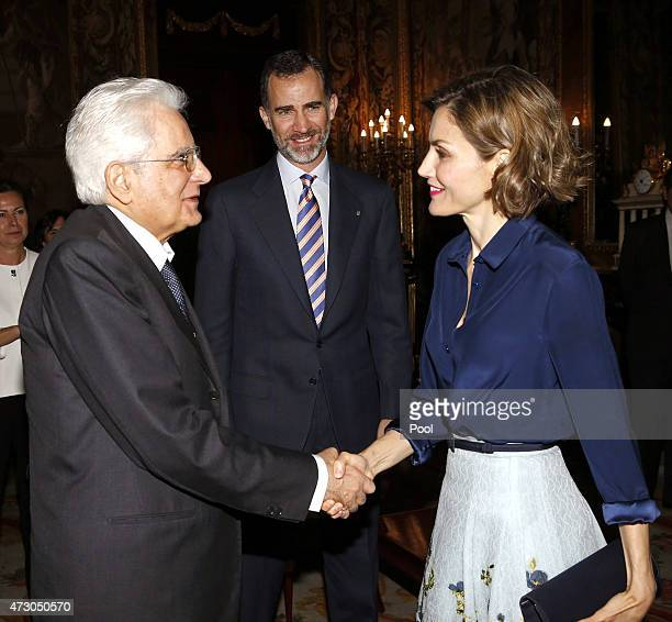 Queen Letizia of Spain greets the president of Italy Sergio Mattarella in the presence of King Philip VI of Spain during a reception at the Royal...