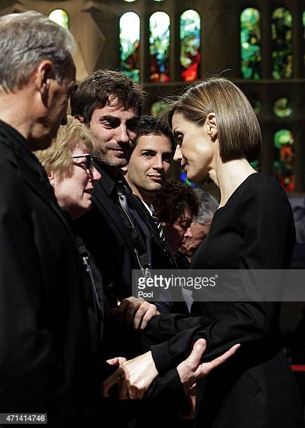 Queen Letizia of Spain greets victim's relatives as she attends the state funeral service for the victims of the Germanwings plane crash at the...