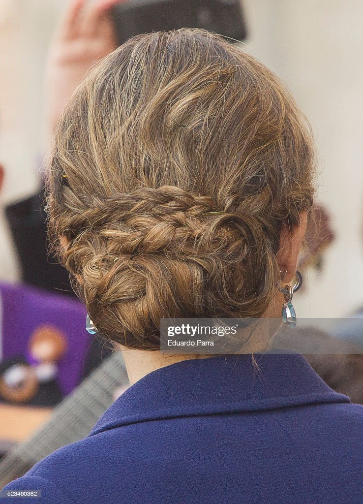Queen Letizia of Spain, hair style detail, poses for photographers at the University of Alcala de Henares for the Cervantes Prize award ceremony on April 23, 2016 in Alcala de Henares, Spain.