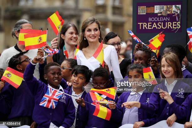 Queen Letizia of Spain meets a group of school children as she arrives at the Weston Library during a State visit to the UK by the King and Queen of...