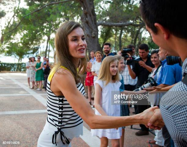 Queen Letizia of Spain shake hands with the journalists followed by her daughters Spanish crown princess Leonor and princess Sofia in the gardens at...